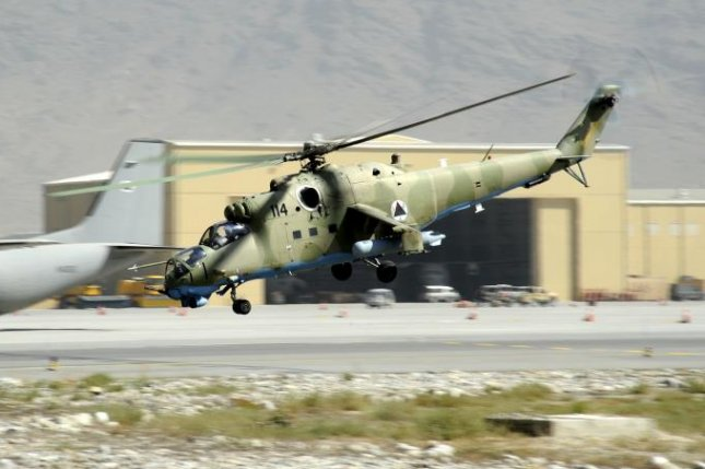 An Afghan air force Mi-35 helicopter takes off from Kabul, Afghanistan. 38th Air Expeditionary Wing photo by Sgt. Matthew Smith