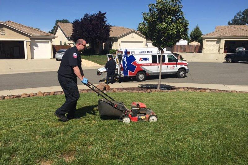 An EMT mows an 87-year-old man's lawn. Photo by Ken Densley/Facebook