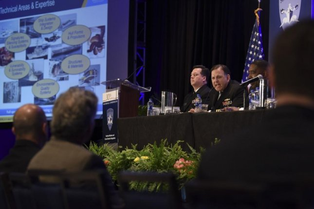 Capt. Mark Vandroff, commanding officer, Naval Surface Warfare Center Carderock Division addresses attendees during the Surface Warfare Domains-Integrating to Win panel at the Surface Navy Association's 30th National Symposium. Photo by Mass Communication Specialist 2nd Class Lauren K. Jennings/U.S. Navy.