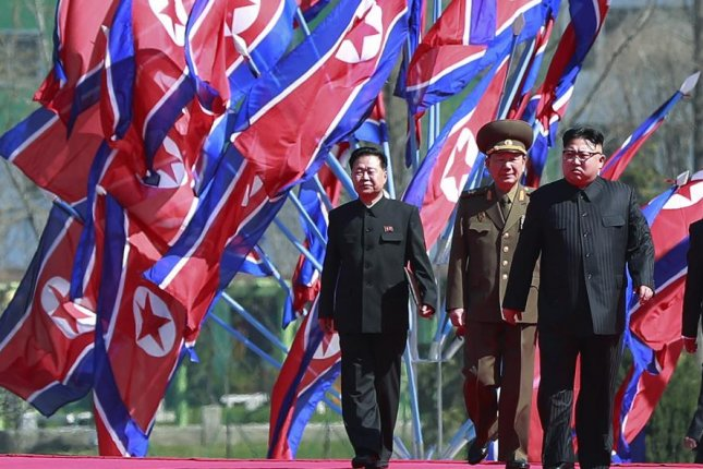 The weapons program of North Korean leader Kim Jong Un (R) is more dangerous than the Islamic State, according to U.S. voters who were recently polled following the test of North Korean missile Hwasong-14. File Photo by How Hwee Young/EPA