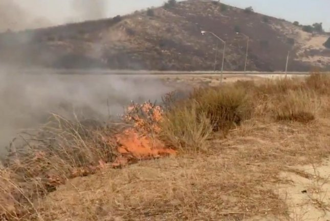 About 60,000 residents of Irvine , Calif., were evacuated Monday after the Silverado Fire scorched 2,000 acres amid high Santa Ana winds in Orange County. Photo courtesy Orange County Fire Authority