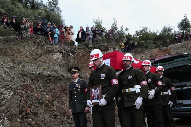 Members of the Military Police of the Turkish Armed Forces carry the coffin of a Turkish soldier after dying in Syria in February. Turkey said its military killed five Kurdish terrorists in Syria this week. Photo by Sedat Suna/EPA-EFE