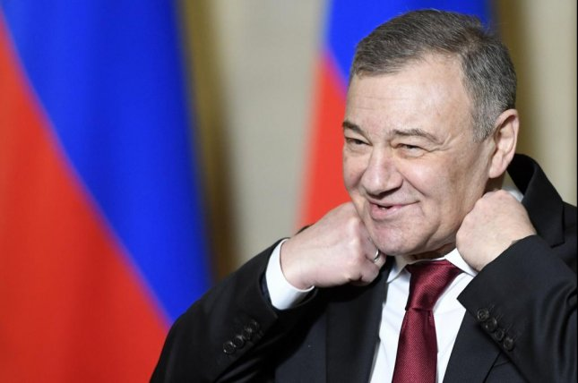 Russian Businessman Arkady Rotenberg prepares for an awards ceremony celebrating the bridge linking mainland Russia to Crimea on March 18. A congressional report Wednesday said Arkady and Boris Rotenberg secretly traded in expensive artwork to get around U.S. sanctions. Photo by Alexander Nemenov/EPA-EFE