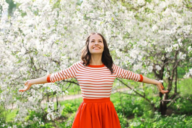 Everybody would prefer to be happy, but a decade-long study in England shows a big smile probably won't help you live any longer. Photo by Rohappy/Shutterstock
