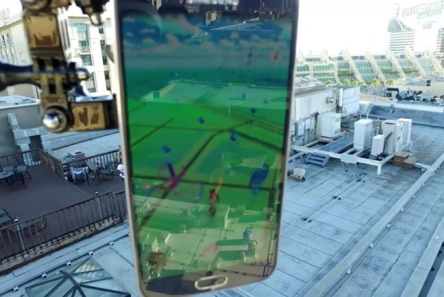 A drone-mounted cellphone being controlled by engineers using another phone is used to play Pokemon Go. Screenshot: Newsflare