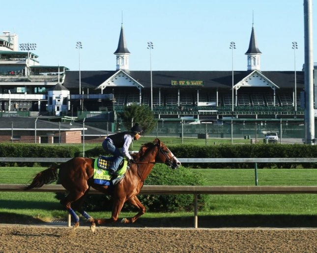 Justify works at Churchill Downs June 4 before shipping to Belmont Park, where he will try to complete a sweep of the Triple Crown. (Churchill Downs photo)
