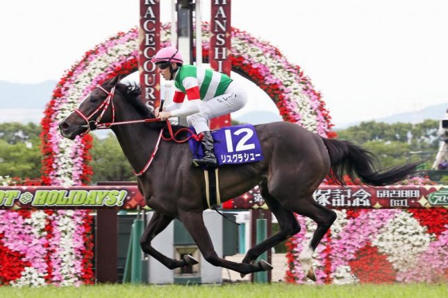 Lys Gracieux wins Sunday's Grade I Takarazuka Kinen, earning berths in the Breeders' Cup and Cox Plate. Photo courtesy of Japan Racing Association