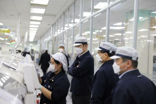 Samsung Electronics workers roll out smartphones in the firm's factory at Gumi, about 125 miles southeast of Seoul. Photo courtesy of Samsung Electronics