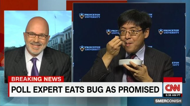 Sam Wang, founder of the Princeton Election Consortium, makes good on a tweeted promise to eat a bug if Donald Trump received more than 240 electoral votes. Screenshot: CNN/YouTube