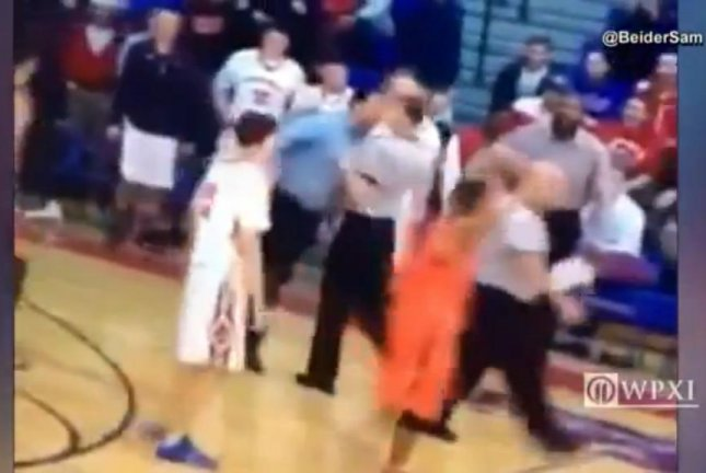 High school coach booted after apparently head-butting referee