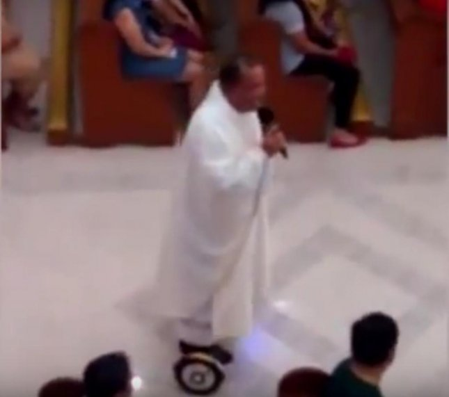 A Catholic priest in the Philippines was suspended after delivering part of his Christmas Eve mass on a hoverboard. The congregation was mostly delighted by his presentation, but his bosses were not. Screen shot: SRC-TV/YouTube.com