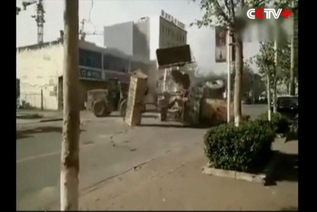 Rival construction firms use heavy equipment to settle their differences in China. Screenshot: CCTV+/YouTube