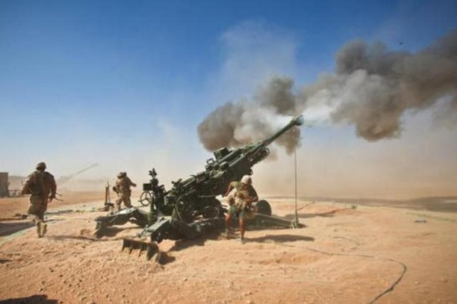 A 155mm howitzer fires a Raytheon Excalibur shell, which features GPS guidance. Photo courtesy Raytheon