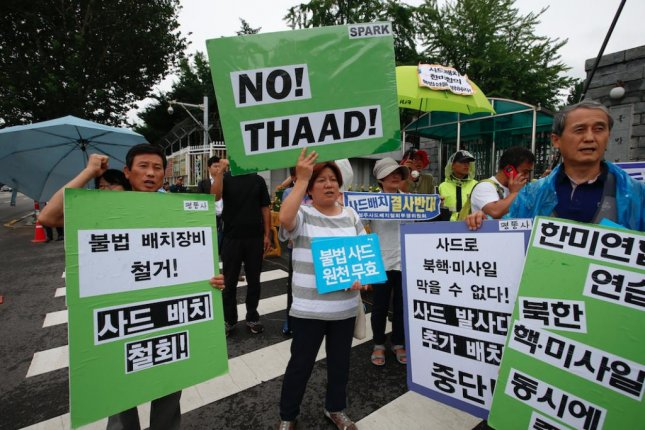 South Korean protesters and Seongju area residents shout slogans and hold banners reading 'No THAAD' during a rally against defense policy in Seoul on Monday. File Photo by Jeon Heon-kyun/EPA