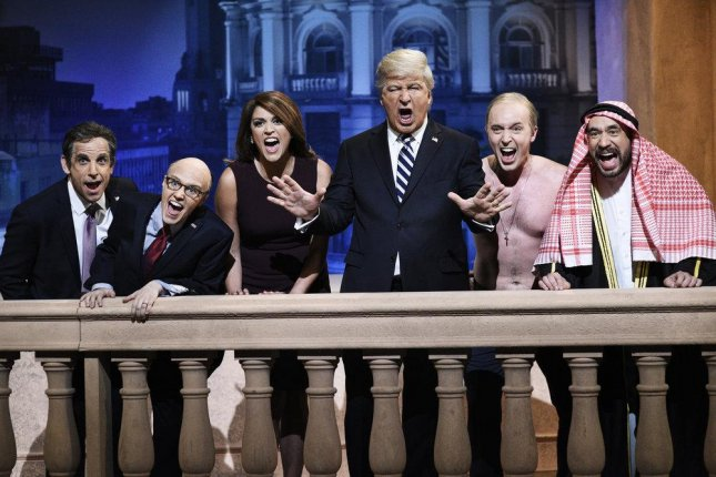 L-R Ben Stiller as Michael Cohen, Kate McKinnon as Rudy Giuliani, Cecily Strong as Melania Trump, Alec Baldwin as Donald Trump, Beck Bennett as Vladimir Putin, and Fred Armisen as Mohammed bin Salman during this weekend's edition of Saturday Night Live. Photo by Will Heath/NBC