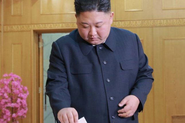 A photo released by the official North Korean Central News Agency (KCNA) shows Kim Jong Un casting his vote on Sunday. Photo by KCNA/EPA-EFE