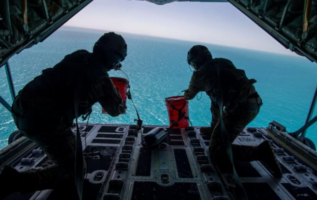 Airmen of the 61st Airlift Squadron load masters drop a simulated sea rescue kit from a C-130J Hercules during a three-week agility exercise. Photo by Senior Airman Aaron Irwin/ U.S. Air Force