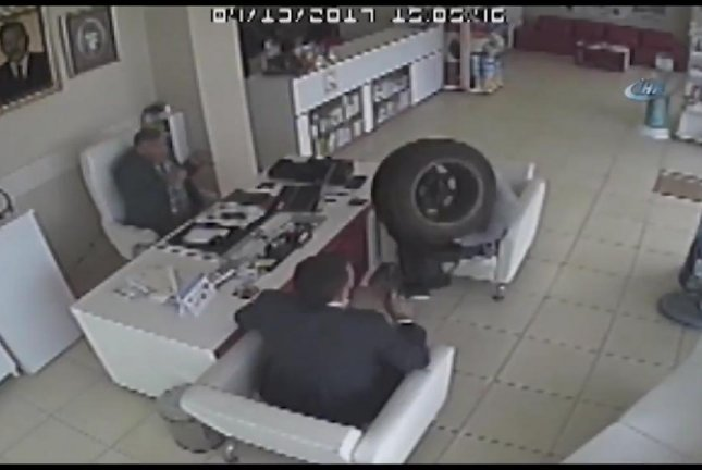 A runaway tire interrupts a meeting at a pharmacy in Turkey after rolling in through the open front door. Screenshot: Daily Sabah/Twitter
