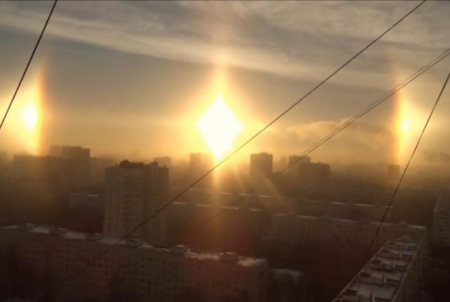 Sundogs appear as duplicate suns in the sky over a Russian city. Screenshot: Newsflare