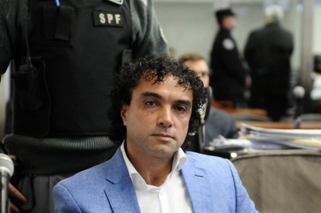 Alleged Colombian drug dealer Henry de Jesus Lopez Londoño is seen during a hearing at a Buenos Aires court in Argentina on May 17, 2016. He is facing cocaine-trafficking charges in Florida. File Photo by Gustavo Amarelle/EPA