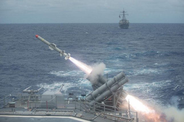 A U.S. Navy cruiser launches a Harpoon missile. U.S. Navy photo by Mass Communication Specialist 3rd Class Kevin V. Cunningham.