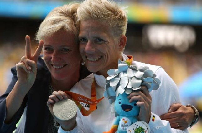 Belgian paralympic athlete Marieke Vervoort, at right, poses with Belgium's Princes Astrid with her bronze medal in the Women's 400M at the Paralympics Games in Rio de Janeiro, Brazil,  on September 10, 2016. File Photo by Marcelo Sayao/EPA-EFE