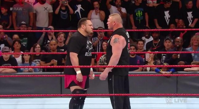 Samoa Joe (L) stares down WWE Universal Champion Brock Lesnar Monday on Raw before the pair began trading blows. Photo courtesy of WWE/Twitter