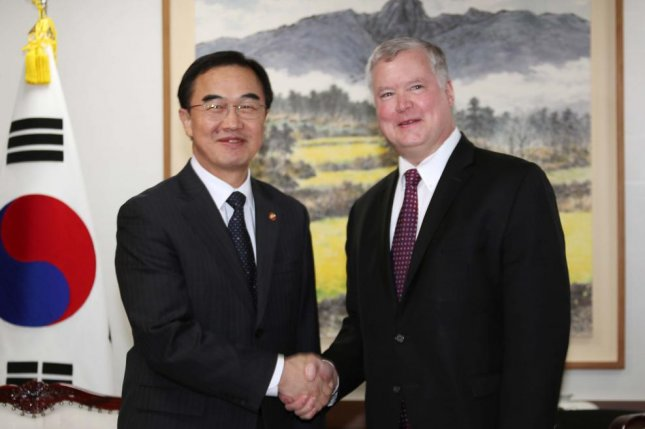South Korean Unification Minister Cho Myoung-gyun (L) shakes hands with Stephen Biegun, U.S. special representative for North Korea, on Tuesday in Seoul. File Photo by Yonhap/EPA-EFE