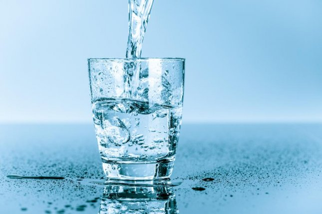 Researchers found that even the EPA-approved safe level of arsenic in drinking water caused early puberty and obesity in mice. Photo by science photo/Shutterstock