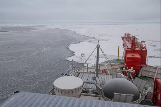 The German research vessel Polarstern prepares to freeze itself to an ice floe in the Arctic Ocean. For the next year, the ship and its research team will drift through the Arctic studying the relationships between air, ocean and ice. Photo by Esther Horvath/AWI