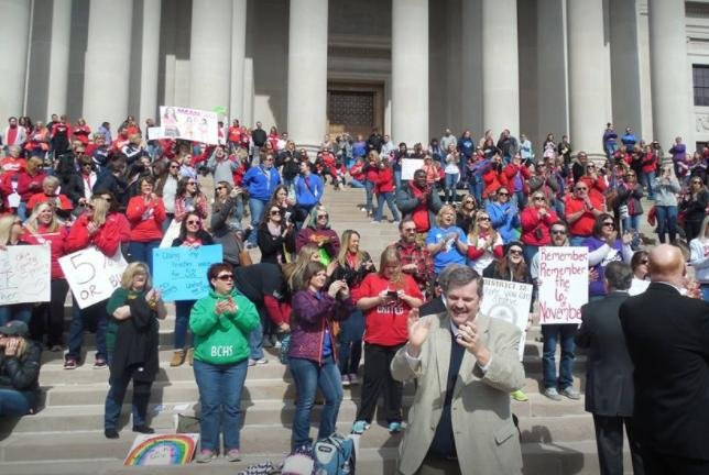 West Virginia teachers protest on the steps of the Capitol building Monday protesting pay rates. On Tuesday, the Senate agreed to a 5 percent raise, ending a labor strike. Photo courtesy WVEA Facebook