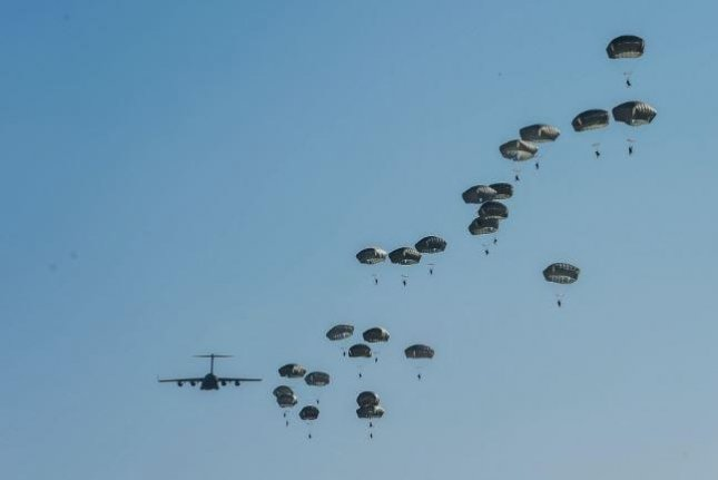 A collaboration between the U.S. Army and the U.S. Air Force, Exercise Predictable Iron, saw over 1,000 paratroopers and 40 tons of equipment dropped from planes at Pope Field, N.C., last week. Photo by Senior Airman Typhana Maybaugh/U.S. Air Force