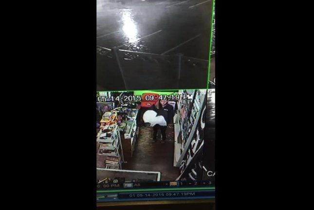 The clerk at the smoke shop in Millcreek recorded narration for the May 14 armed robbery at the store and shared it with her sister, who posted it on Reddit. 801 801/YouTube video screenshot