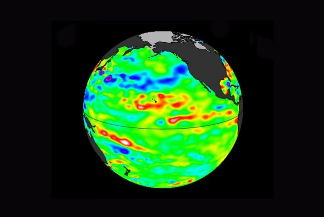 Sea level data show a warm band surrounding Hawaii, heat leftover from the last El Niño, which researchers say could fuel a new one. Photo by NASA/JPL-Caltech