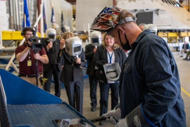 In a ceremony on Wednesday, a welder at Fincanteri Mariette Marine in Marinette, Wis., welded the initials of ship's sponsor into the keel of the future USS Cleveland. Photo courtesy of Team Freedom/Lockheed Martin/Flickr