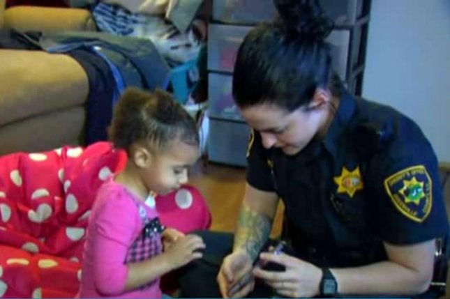 A South Carolina toddler called 911 to get some help putting on her pants. Screenshot: WHIO-TV