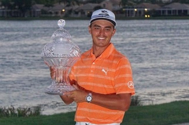 Rickie Fowler holds the trophy after winning the 2017 Honda Classic. (PGA Tour/Instagram)