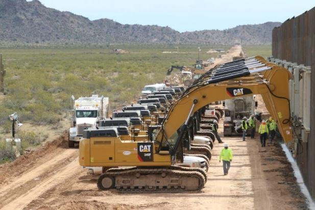 A barrier on the U.S.-Mexico border at Yuma, Ariz., is installed. An Inspector General's report on Tuesday said that U.S. military deployments for the project are compliant with federal law and Defense Department policy. Photo courtesy of U.S. Army Corps of Engineers