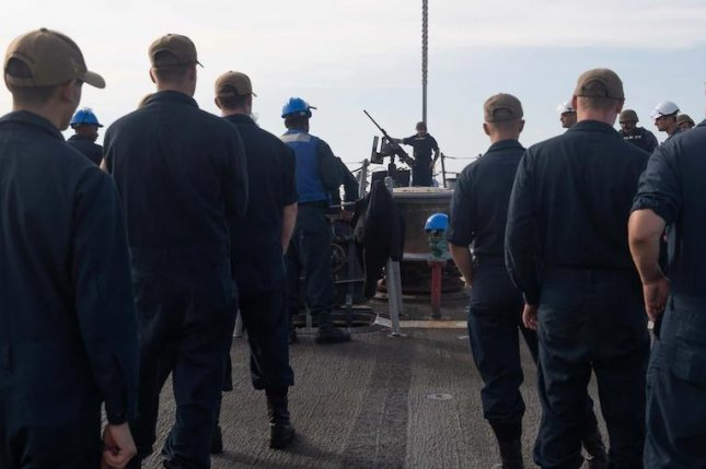 Sailors aboard the USS Arleigh Burke guided missile destroyer prepare to depart Naval Station Rota, Spain, on Monday. Photo courtesy of U.S. Navy