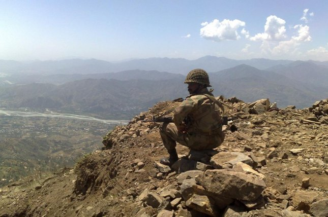 A Pakistani soldier keeping watch at Baine Baba Ziarat in the Swat valley, pictured in 2009. (Flickr/Al Jazeera English)