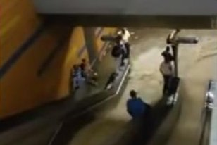 Flood waters rush into a Caracas, Venezuela, subway station. diana valbuena/YouTube video screenshot