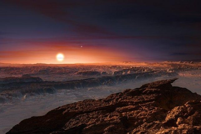ESO astronomers with the Pale Red Dot project announced the presence of a habitable planet orbiting our closest stellar neighbor, Proxima Centauri. Pictured, an artistic rendering shows what the red dwarf star might look like from the surface of the newly discovered exoplanet, Proxima b. Photo by ESO/M. Kornmesser