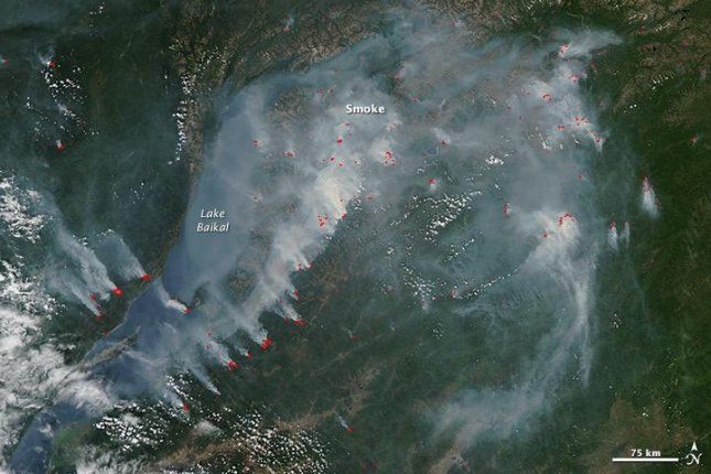 NASA's Aqua satellite and its MODIS cam captured imagery of the wildfires burning in south central Russia, near Lake Baikal. Photo by NASA/Jeff Schmaltz/MODIS/LANCE/EOSDIS