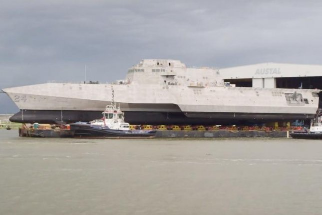 Austal USA has received a $7.9 million contract modification for work on the USS Oakland, pictured here at its launch in July. Photo courtesy of Austal