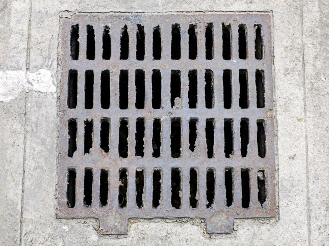 Yasuomi Hirai, 28, allegedly hid in a sewer in Kobe for five hours in order to use his smartphone to film up women's skirts. He was arrested for the same crime in 2013. nuwatphoto/Shutterstock