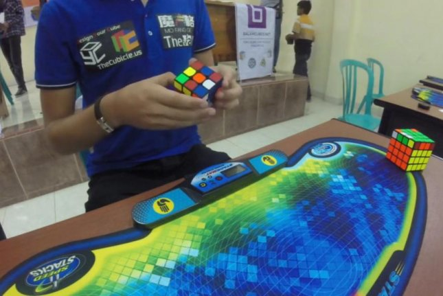 Mats Valk prepares to break the Rubik's cube world record during a competition in Indonesia. Screenshot: Newsflare