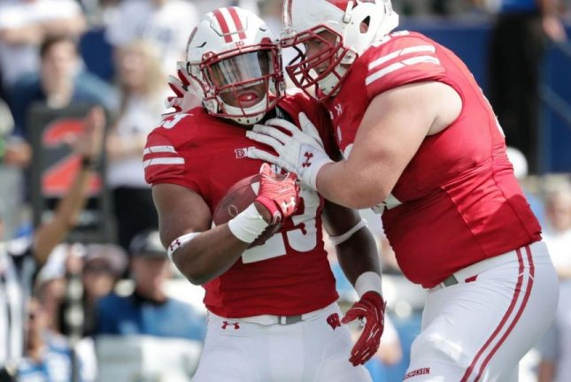 Dynamic freshman running back Jonathan Taylor (23) is following in the mold of other great Wisconsin running backs such as Melvin Gordon, Montee Ball and Ron Dayne. Taylor ranks 10th nationally by averaging 129 rushing yards per game. Photo courtesy of Wisconsin Football/Twitter