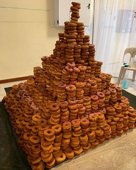 The Jewish Life Center in Johannesburg, South Africa, broke a Guinness World Record by constructing a doughnut tower measuring just under 60 inches tall. Photo courtesy of Guinness World Records