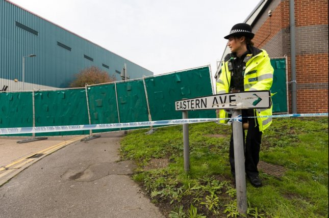 Police investigate at Waterglade Industrial Park in Grays, Essex, Britain, on Wednesday, where 39 bodies were discovered inside a lorry container. Photo by Vickie Flores/EPA-EFE