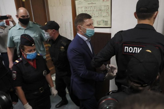 Russian policemen escort arrest governor of Khabarovsk territory Sergei Furgal to Basmanny district court in Moscow, Russia Friday. Sergei Furgal was arrested Thursday on charges connected to several contract killings of businessmen, his business partners in 2004-2005. On Saturday tens of thousands of protesters demonstrated across Khabarovsk in opposition to the arrest, which critics say was politically motivated. Photo by Maxim Shipenkov/EPA-EFE